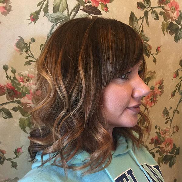 Medium Hair Cut With Bangs